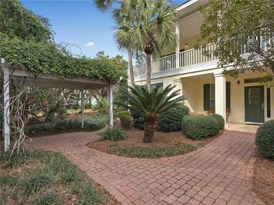 Photo for 3 BR Beach Home / Steps from the Beach / 4 Complimentary bikes to Ride Around Gated Community