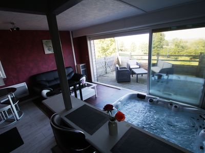 Photo for Chalets with private spa facing Mont St Michel