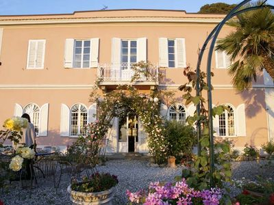Photo for In a beautiful roses garden a pink Villa watching the Tirreno Sea close to Pisa
