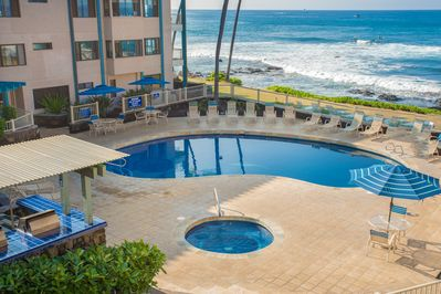Amazing pool area with lots of chaise lounges oceanfront.