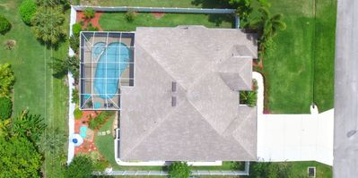 One beautiful home with privacy  fence and professional  tropical landscaping!