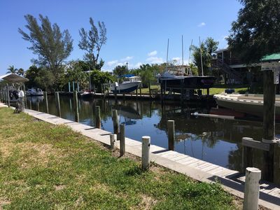 """Photo for """"Tropic Bird"""", a boaters retreat, Waterfront canal home with boat dock."""