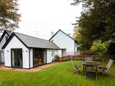 Photo for Romantic Forest Cottage with private garden, dog friendly, forest views from bed