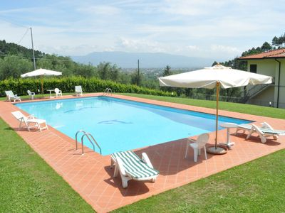 Photo for 4 bedroom Apartment, sleeps 8 with Pool, FREE WiFi and Walk to Shops