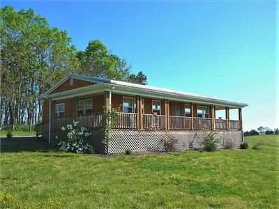 Photo for Nestled on a spacious horse ranch