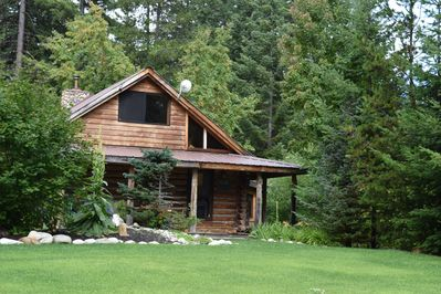 Side view of cabin with a great big yard for your pets and kids to play
