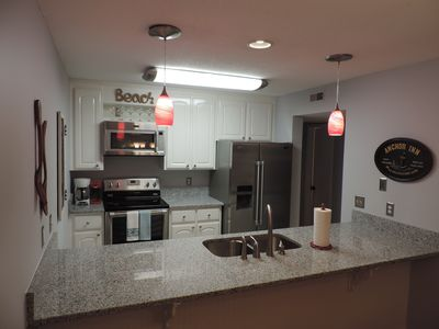 Totally Updated kitchen, new granite, stainless appliances, lighting