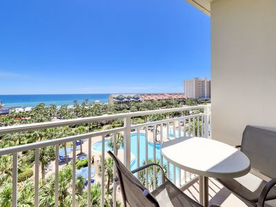 Photo for Modern condo overlooking views of the gulf - gym, pool & beach access!