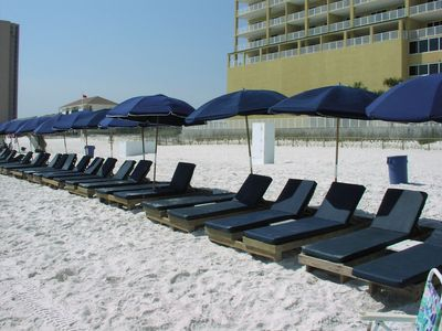 Complimentary beach service includes two chairs, pads, and an umbrella each day.