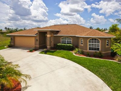 Photo for Beautiful 4 Bedroom Canal Home With Heated Pool