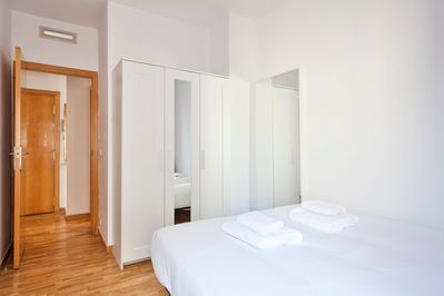 Another bedroom with th a double bed + wardrobe