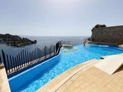 Photo for 4 bedroom Apartment, sleeps 8 with Air Con, FREE WiFi and Walk to Beach & Shops