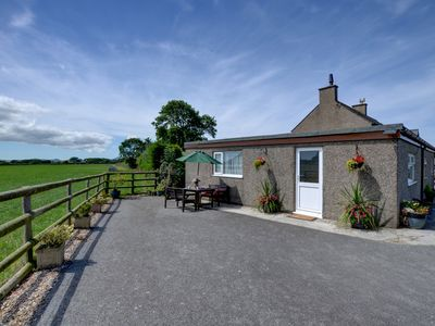 Photo for Near Pwllheli on the owners' working farm is Plas Isaf Cottage, with lovely views of the countryside