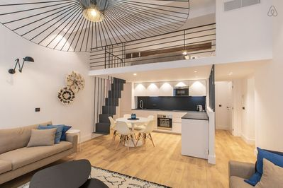 Living-room with open plan kitchen