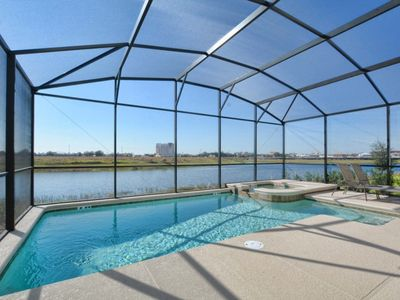 Photo for GREAT LOCATION..MINUTES TO DISNEY, GAMEROOM, LAKEFRONT, 2 MASTER SUITES, HOT TUB