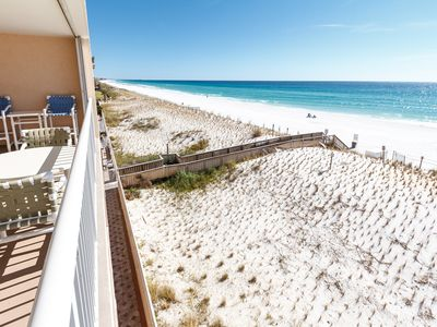 Views from your private balcony - The views from this 4th floor balcony condo are just spectacular. Pictured is the walkover you'll follow to the beach! Look at that gorgeous blue water waiting for you!