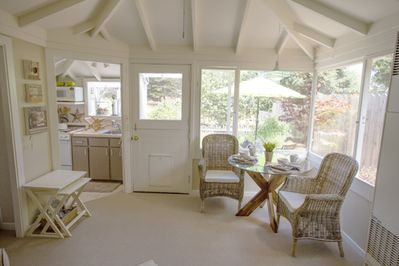 Entering the front door to the light filled cottage with beamed ceilings
