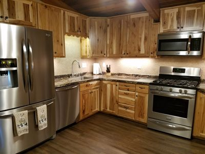 Full kitchen with modern stainless steel appliances