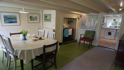 dining area in cottage with cosy oil fuelled  rayburn for optional use in winter