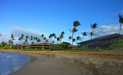 Photo for Beach front.  Walk straight out to the beach or lounge on the patio and enjoy the amazing view.