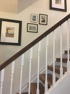 Coastal Staircase leading to all three bedrooms and master bath.