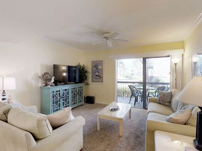 Photo for A cozy condo with shared pools/hot tub and a private lagoon-view patio!
