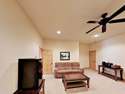 1st Bedroom - The 1st bedroom offers a seating area with a couch and coffee table.