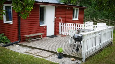 The porch and outdoor seating area of the cabin