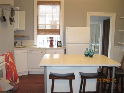 Kitchen with large stone island and counters