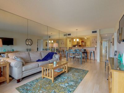 Photo for Beautiful condo in a gated resort w/ shared pool, hot tub, gym, & tennis