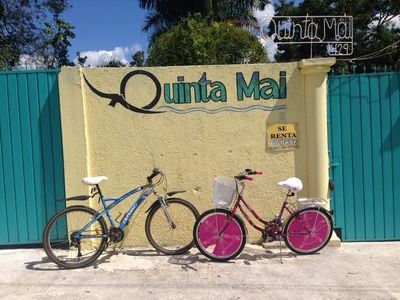 Two rental bikes in front of the Quinta Mai sign