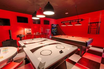 Super Game Room with 4 t.v., and 2 gaming chairs