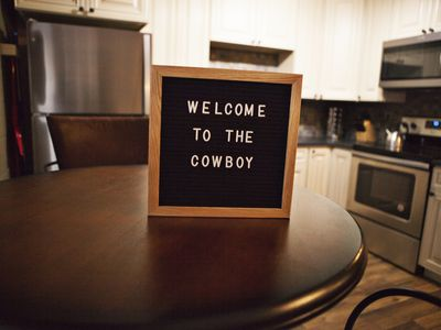 Photo for Downtown Bigfork - The Cowboy-themed condo in the American Building