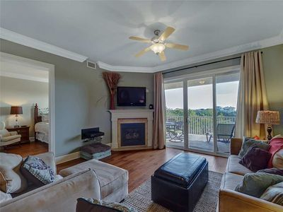 Photo for Spacious 4 BR Condo on Relaxing Dune Lake with Complimentary Pontoon Boat Ride to Beach