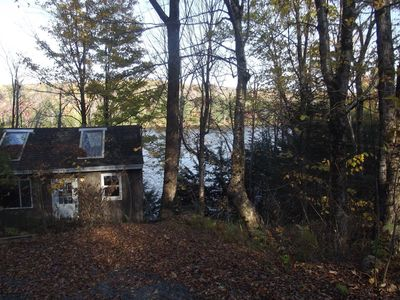 Photo for Rustic Waterfront Camp w Deck, boats w Loons, Beaver, wildlife,Lake Sunapee Area