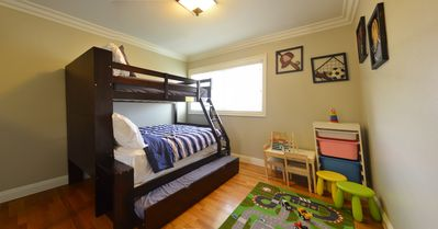 Full bunk bed with trundle bed (sleep 4)  and playing corner for kids, upstairs.