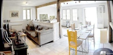 The spacious,light interior with stone walls, oak beams and quality furnishings.