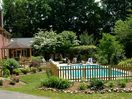 A gazebo, large grill and pool make for a great family picnic.