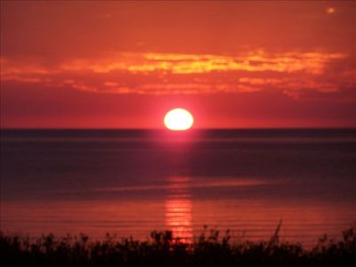 Photo for Gorgeous Sunsets from Beautiful Homestead Beachfront Condo on Sleeping Bear Bay