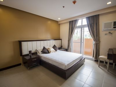 Photo for 2BR Executive Suite near Ayala, free weekly housekeeping, cable, wifi & parking