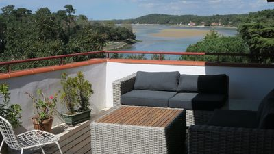 Photo for Beautiful Lake View, City Centre Hossegor, 10 min walk Ocean, Grand Terrace