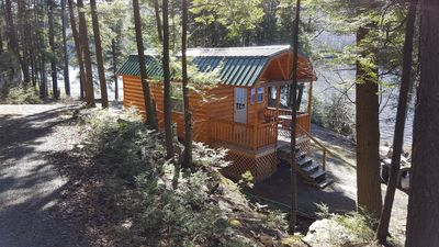 Photo for Lakefront log cabin, modern amenities, sleeps 6, totally secluded, pets ok