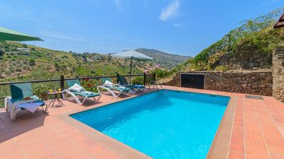 Photo for Elegant villa with magnificent panoramic views from the pool