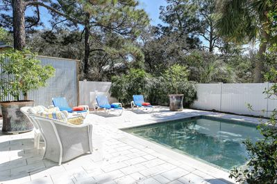 Private fenced in pool lounging area