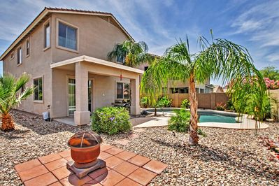 This Queen Creek vacation rental house boasts a large yard with lush greenery, which is private and great for hosting!
