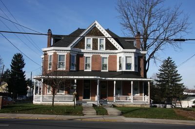 This photo shows both Glass Gable North and South.  Glass Gable North consists of the Second and Third Floors on the right side of this photograph. When entering Glass Gable North from the front, you use the side walk and front door shown on the right in this photo.