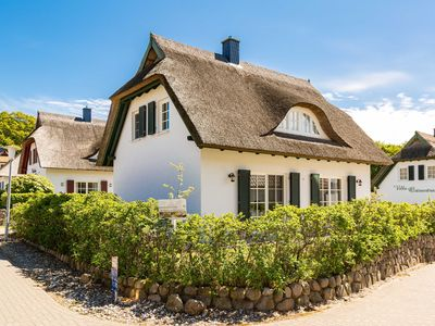 Photo for Thatched cottage on the coastal forest