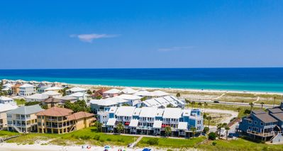 Photo for Adorable condo just steps from the emerald green gulf waters!