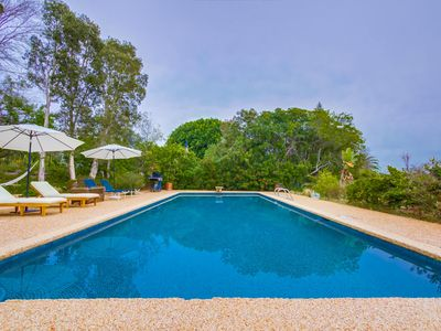 NEW LISTING......Poolside resort style living in 2 bedroom home