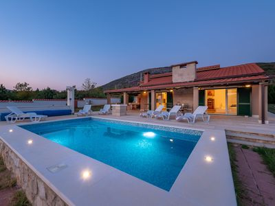 Photo for This 3-bedroom villa for up to 6 guests is located in Trogir and has a private swimming pool, air-co